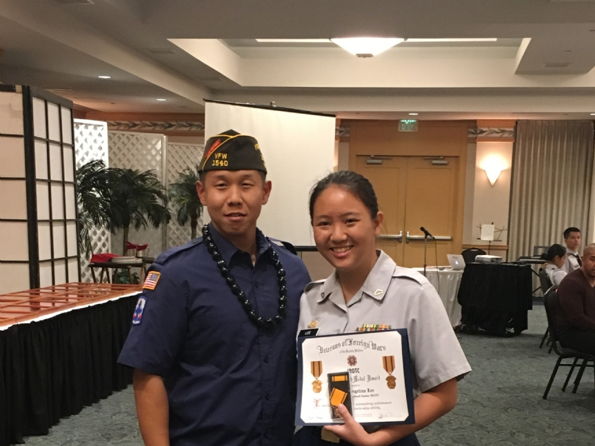 Angelina Lee was awarded by VFW Post 1540's Bryan Choe